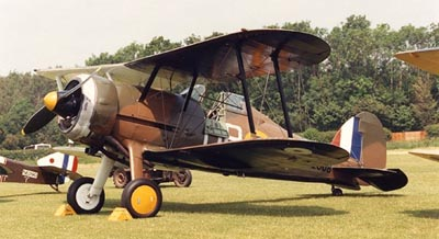 A camouflage gladiator warbird at an airshow